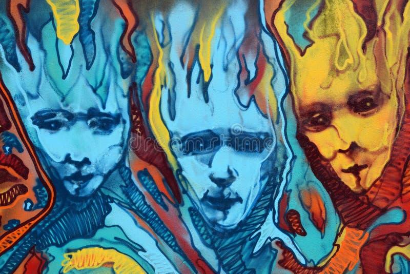 Pintada torcida de las llamas de las caras foto de archivo