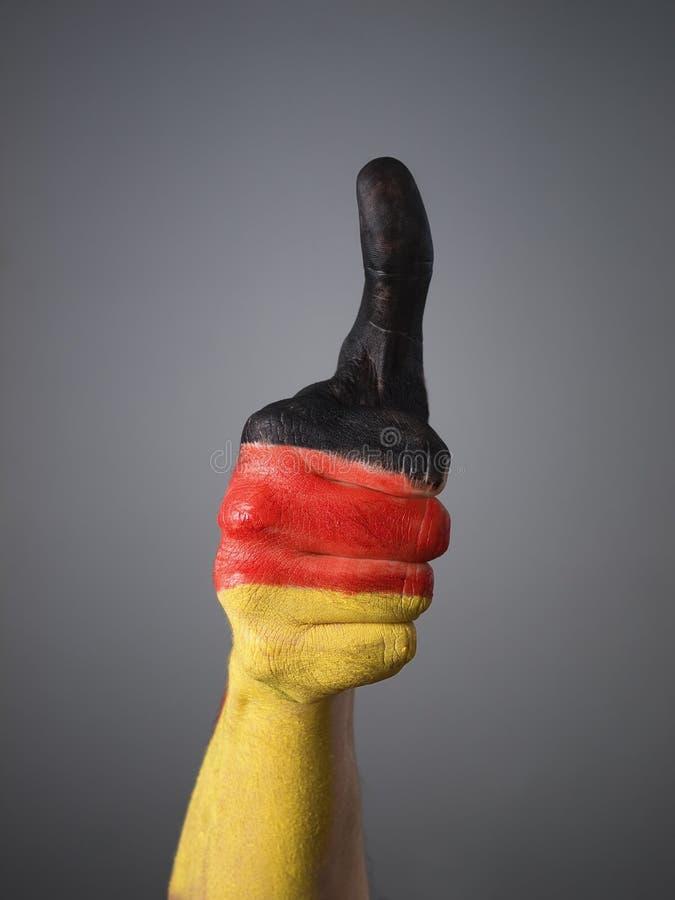 Pintado a mano con el indicador de Alemania 2 imagenes de archivo