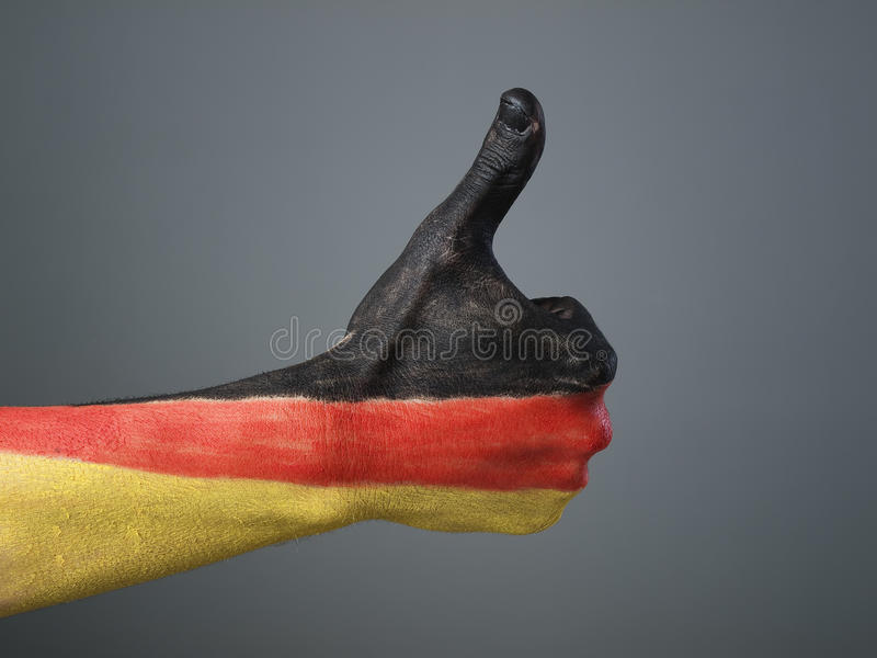 Pintado a mano con el indicador de Alemania fotografía de archivo