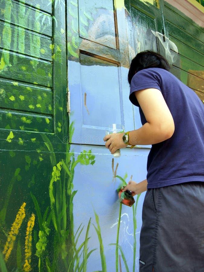 Pintando uma casa fotografia de stock royalty free