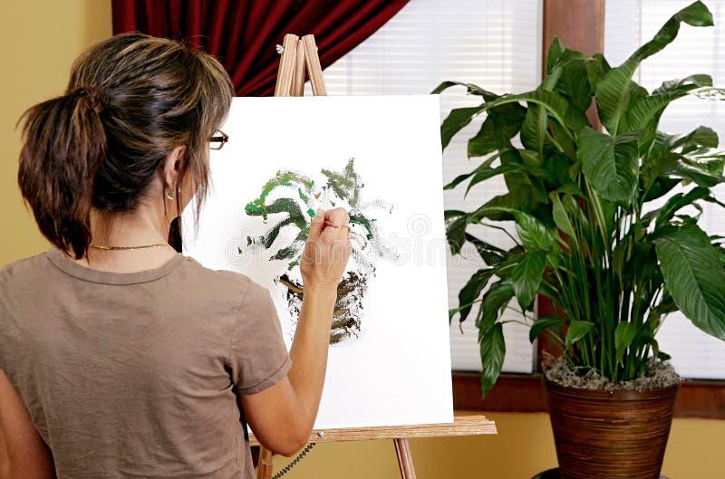 Pintando uma planta fotografia de stock