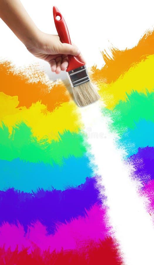 Pinte el raimbow con el cepillo imagen de archivo