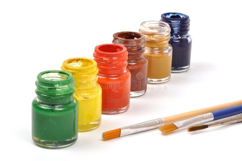 Pinte frascos & escovas fotografia de stock