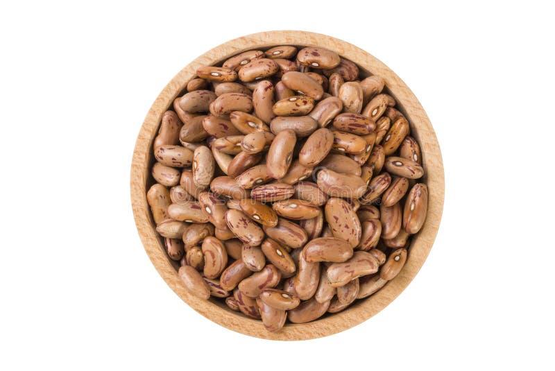 Pinto φασόλι στο ξύλινο κύπελλο που απομονώνεται στο άσπρο υπόβαθρο διατροφή Συστατικό τροφίμων στοκ εικόνα