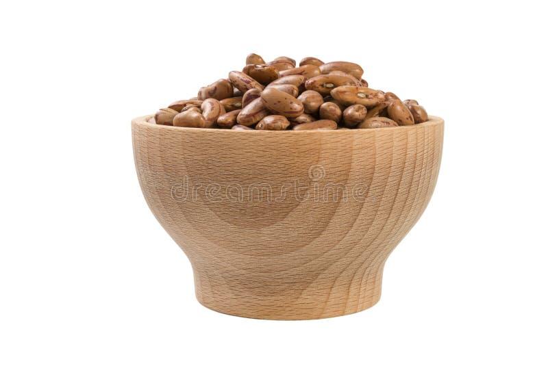 Pinto φασόλι στο ξύλινο κύπελλο που απομονώνεται στο άσπρο υπόβαθρο διατροφή Συστατικό τροφίμων στοκ φωτογραφίες