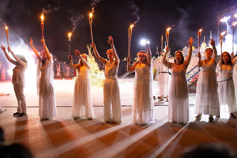 PINTO,MADRID, SPAIN - JUNE 23, 2019: People celebrate St John`s Eve around a bonfire with Iris Witches in a village in Spain. St. John`s eve celebration around stock photo