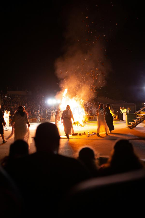 PINTO,MADRID, SPAIN - JUNE 23, 2019: People celebrate St John`s Eve around a bonfire with Iris Witches in a village in Spain. St. John`s eve celebration around royalty free stock image