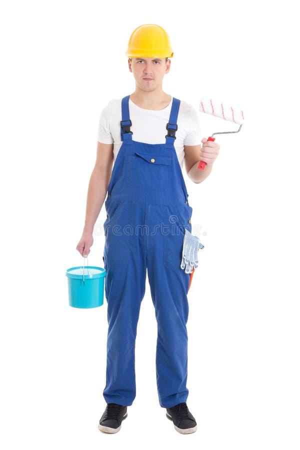 Pintor del hombre joven en las batas azules aisladas en blanco imagen de archivo libre de regalías