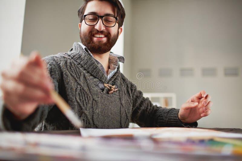 Pintor feliz imagenes de archivo