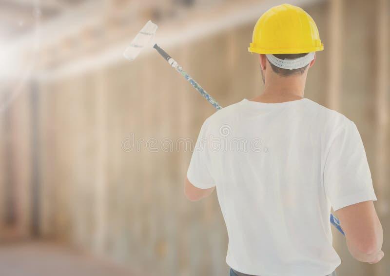 Pintor no terreno de construção fotos de stock royalty free