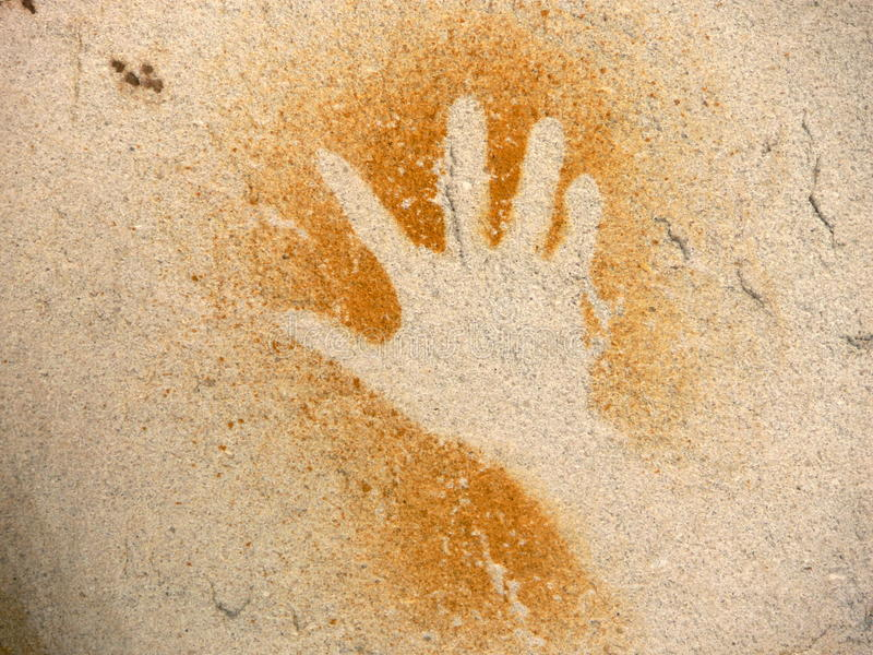 Pintura aborígene da rocha, mão imagem de stock royalty free