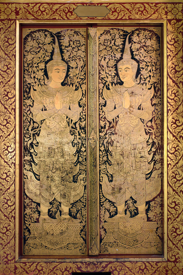 Pintura antigua tailandesa del ángel del oro del arte foto de archivo