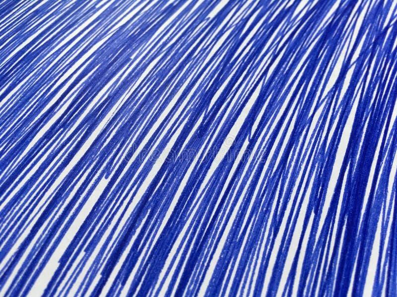 Pintura azul no Livro Branco imagem de stock