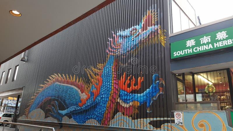 Pintura da arte dos grafittis de chinatown toronto do dragão imagens de stock