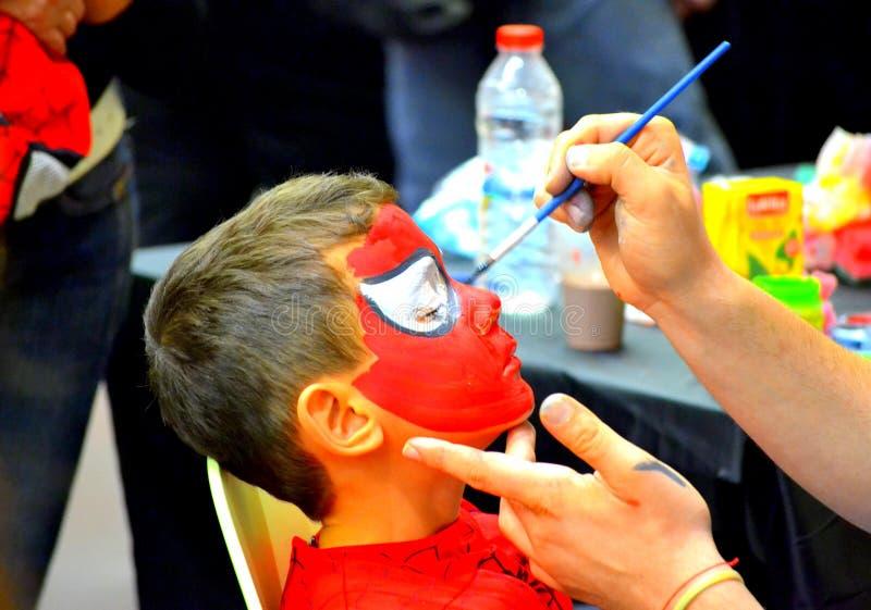 Pintura da cara do menino fotografia de stock royalty free