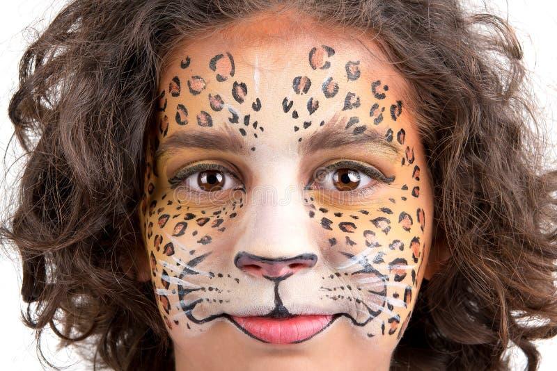 Pintura da cara, leopardo fotografia de stock