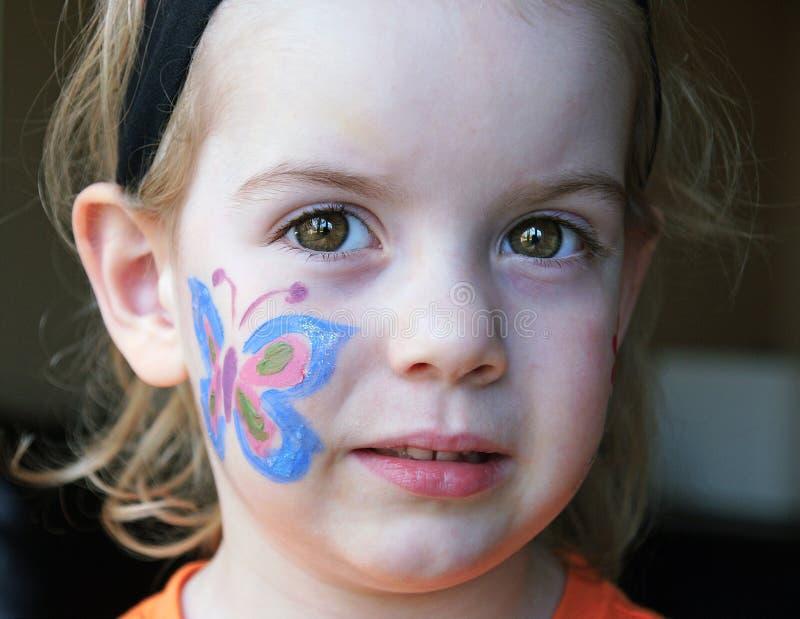 Pintura da cara da borboleta imagens de stock