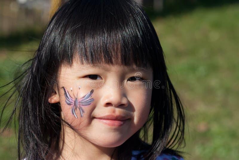 Pintura da face da menina imagem de stock