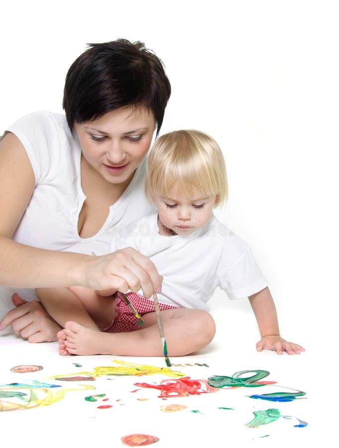 Pintura da matriz e da criança sobre o branco imagens de stock royalty free