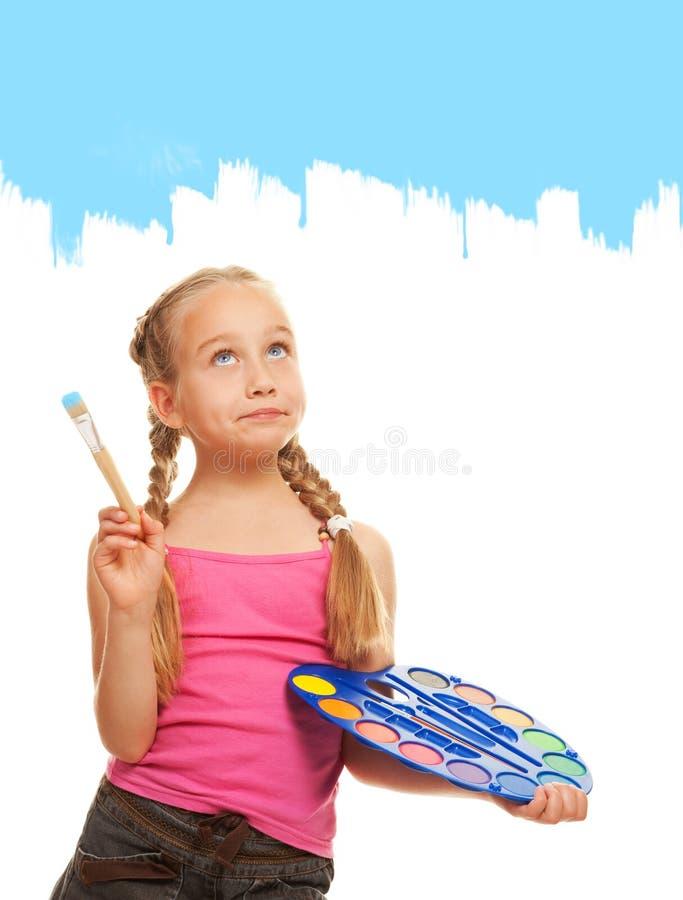 Pintura da menina com pintura azul foto de stock royalty free