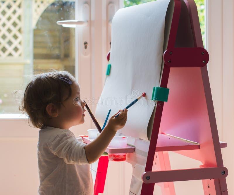 Pintura da menina na armação fotos de stock royalty free