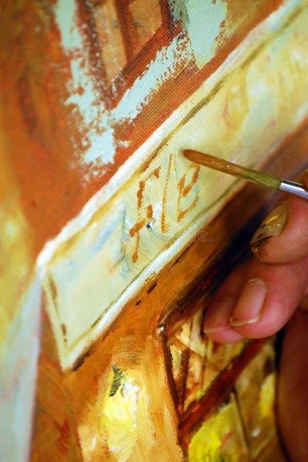 Pintura de la mano del artista imagen de archivo libre de regalías