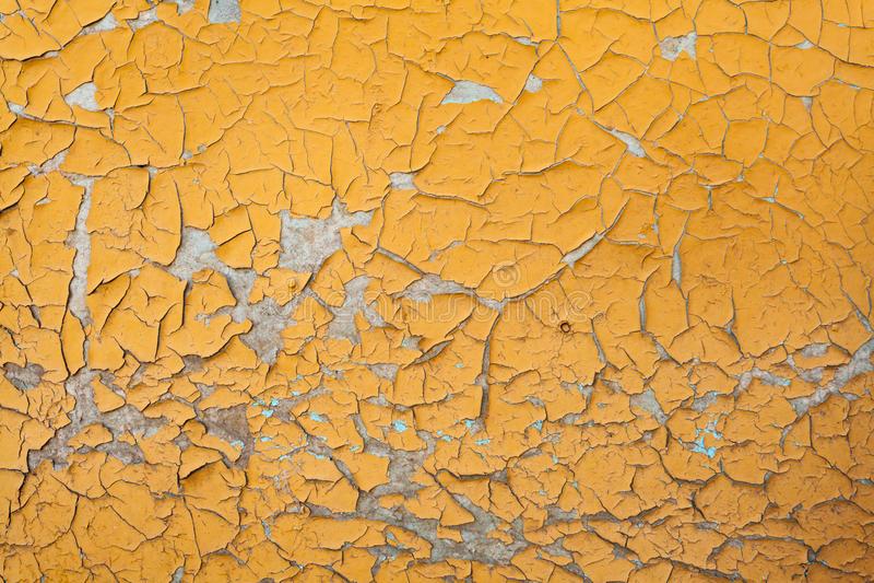 Pintura de la peladura en textura inconsútil de la pared Modelo del material amarillo rústico del grunge fotografía de archivo