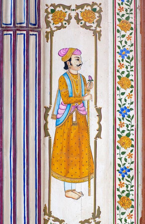 Pintura de pared colorida tradicional en el haveli viejo en Jaipur, Rajasthán, la India foto de archivo