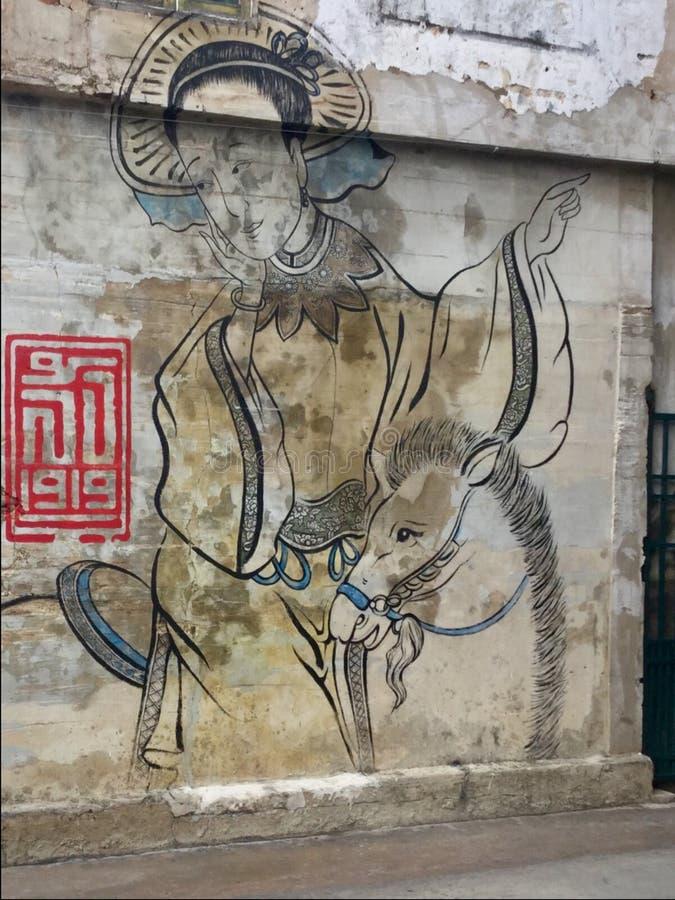 Pintura de pared Mujer y caballo mural Lhong 1919 bangkok tailandia imagen de archivo libre de regalías