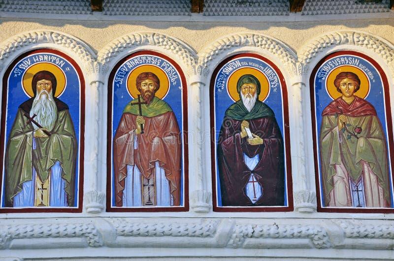 Pintura de pared religiosa: cuatro santos imagen de archivo libre de regalías