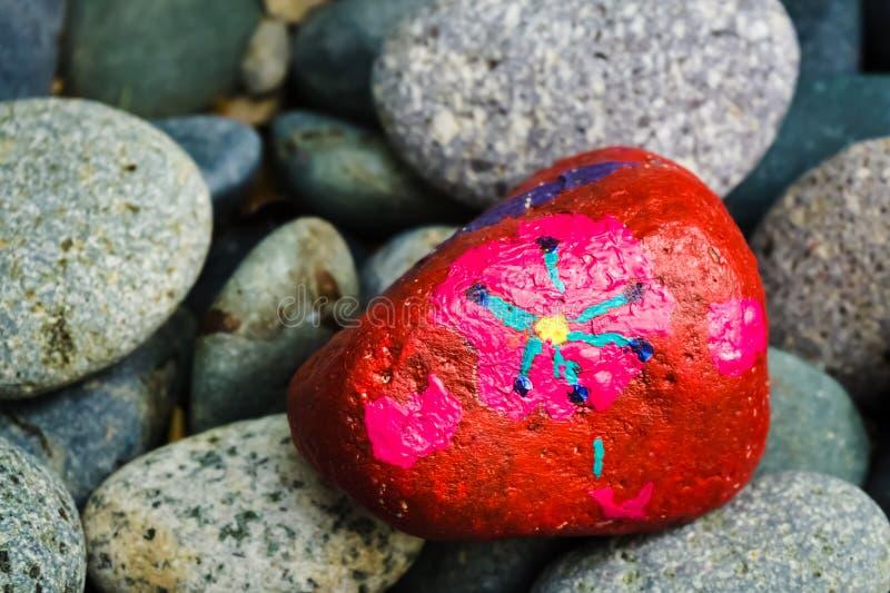 Pintura de pedra - flor fotografia de stock