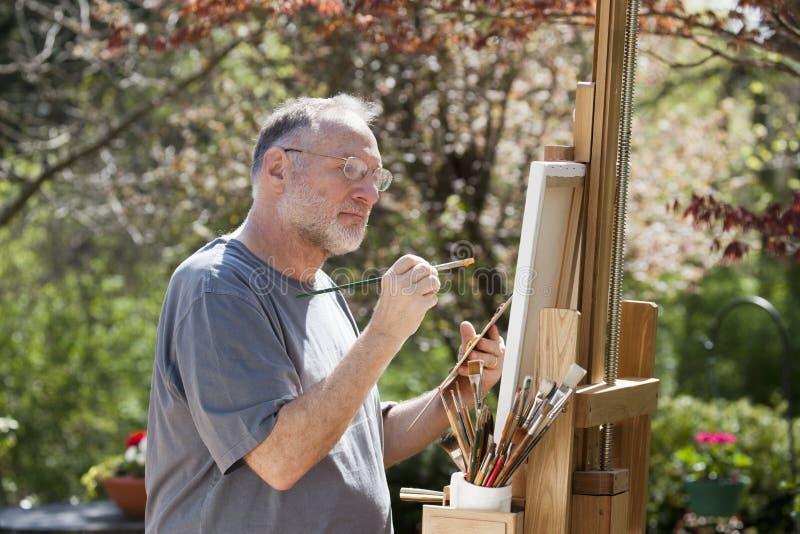 Pintura del hombre al aire libre foto de archivo