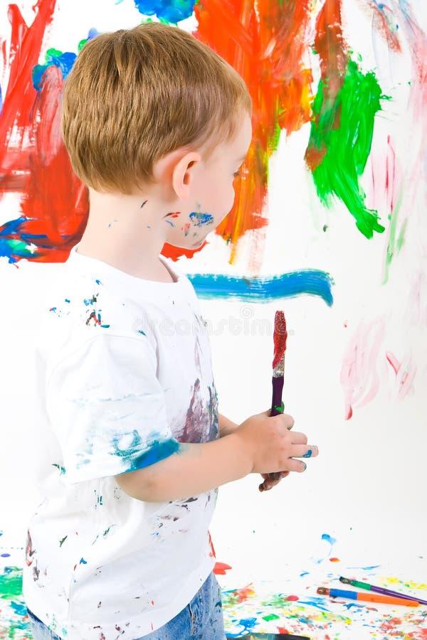 Pintura del niño en la pared imagen de archivo libre de regalías