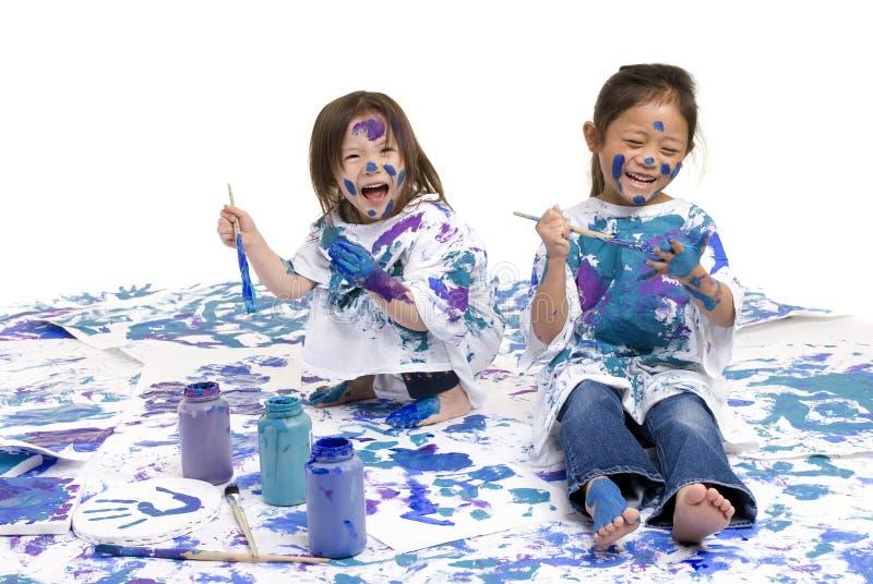 Pintura del suelo de las muchachas de la niñez fotografía de archivo