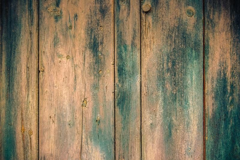 Pintura descolorada vieja en los tableros de madera imagenes de archivo
