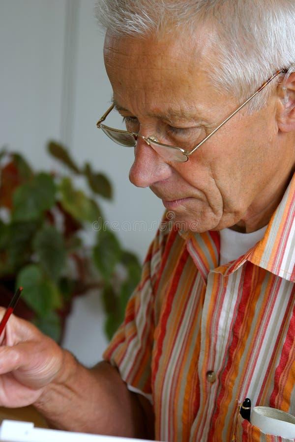 Pintura do homem mais idoso fotos de stock royalty free