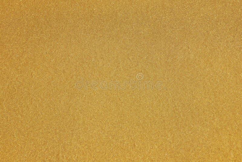 Pintura do ouro amarelo com flocos de brilho imagens de stock
