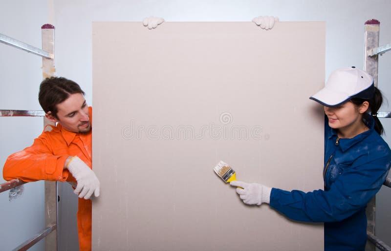 Pintura dos trabalhadores da construção imagens de stock
