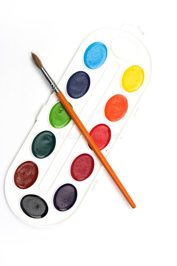 Pintura e escova da aguarela foto de stock