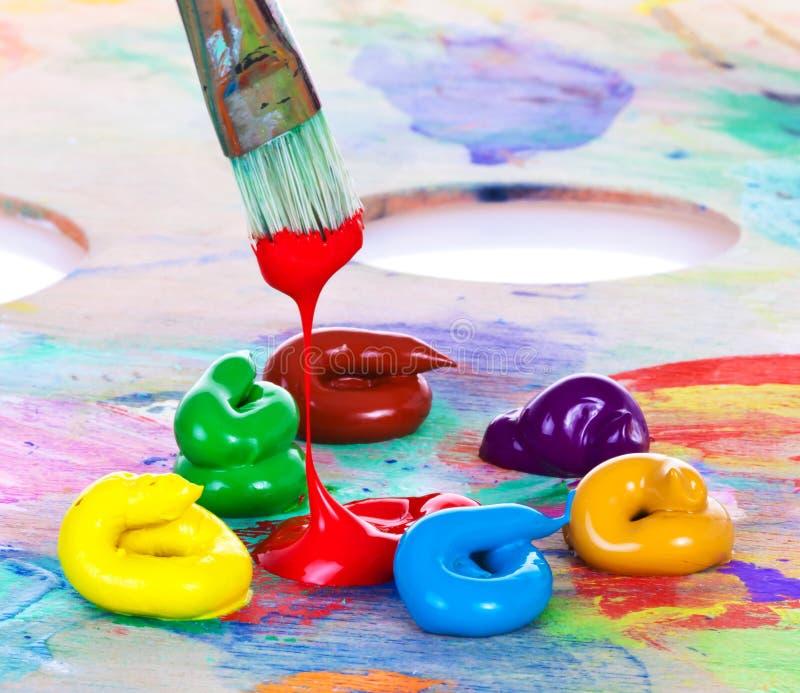 Pintura e escova de petróleo imagens de stock royalty free
