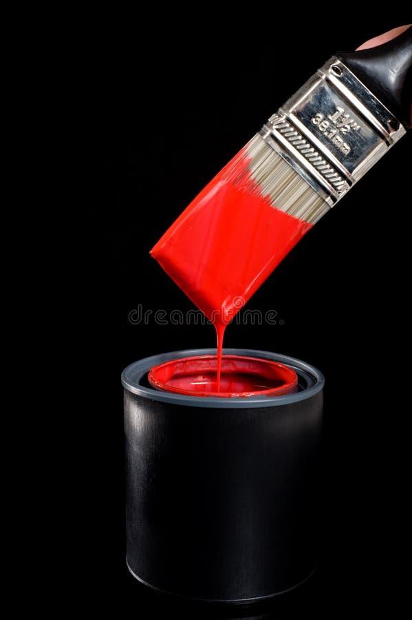 Pintura e escova vermelhas imagem de stock