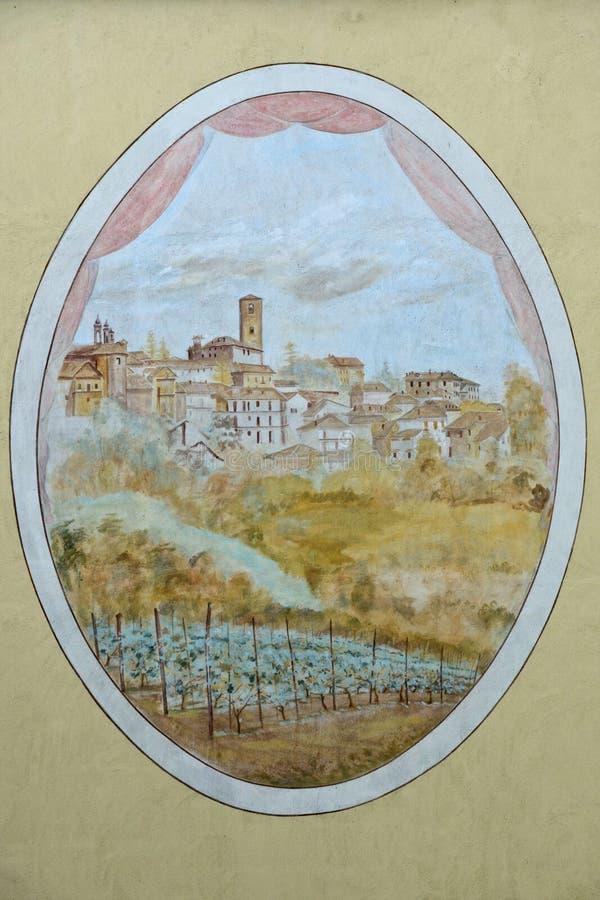 pintura en la pared de un edificio que representa el pueblo medieval de Neive imagen de archivo libre de regalías