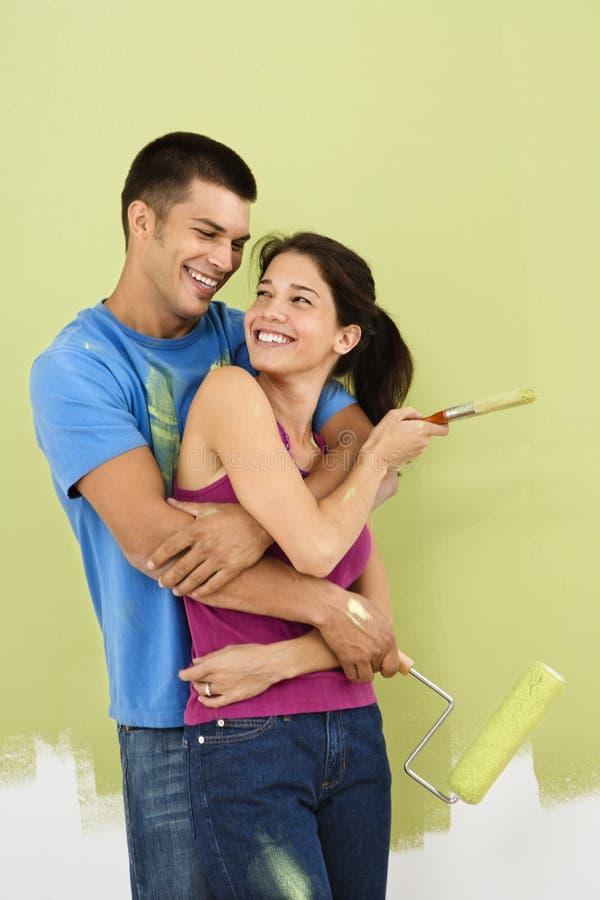 Pintura feliz dos pares. imagens de stock royalty free