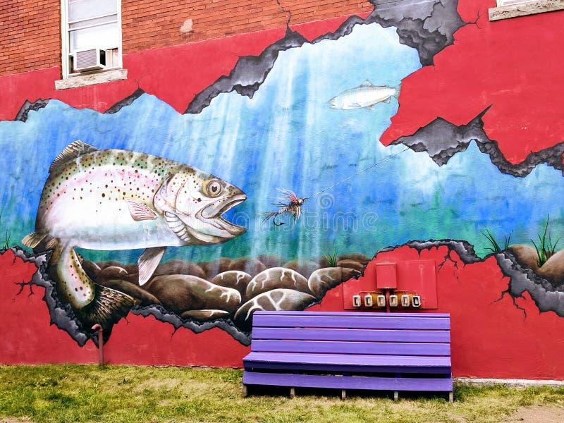 Pintura mural cortante da rua dos peixes fotografia de stock