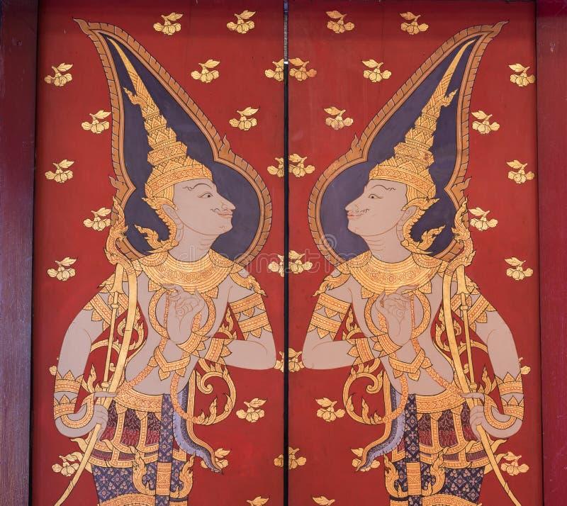 Pintura mural tailandesa tradicional a vida da Buda e da vida tailandesa imagens de stock