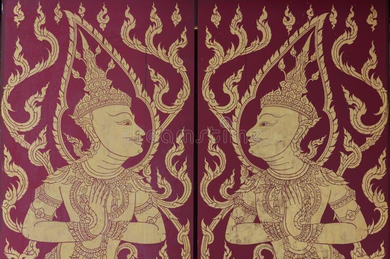 Pintura mural tailandesa tradicional a vida da Buda e da vida tailandesa foto de stock royalty free