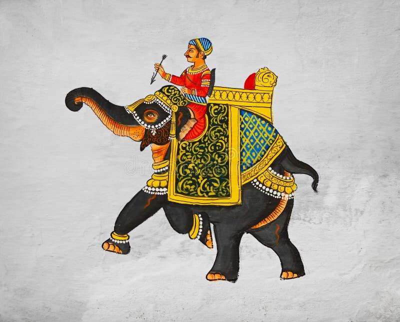 Pintura mural tradicional - imagem do maharaja da equitação em um elefante. imagem de stock royalty free
