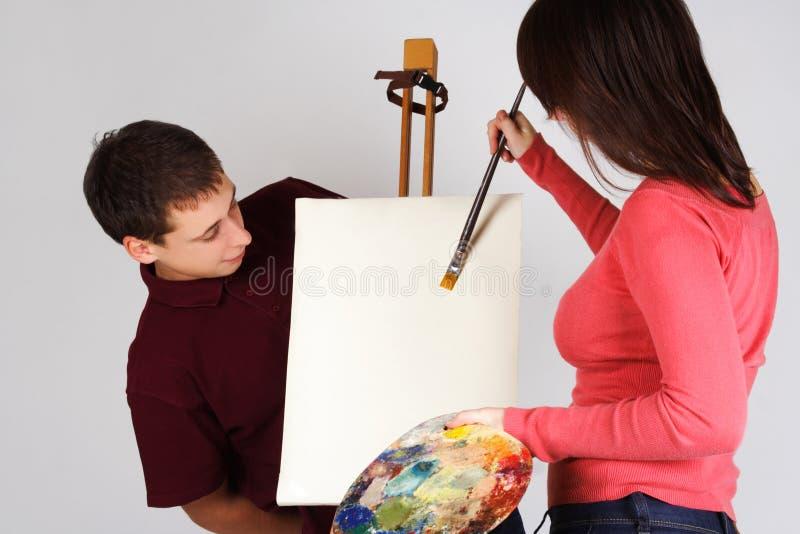 Pintura na armação da lona, vista da menina do homem fotografia de stock royalty free