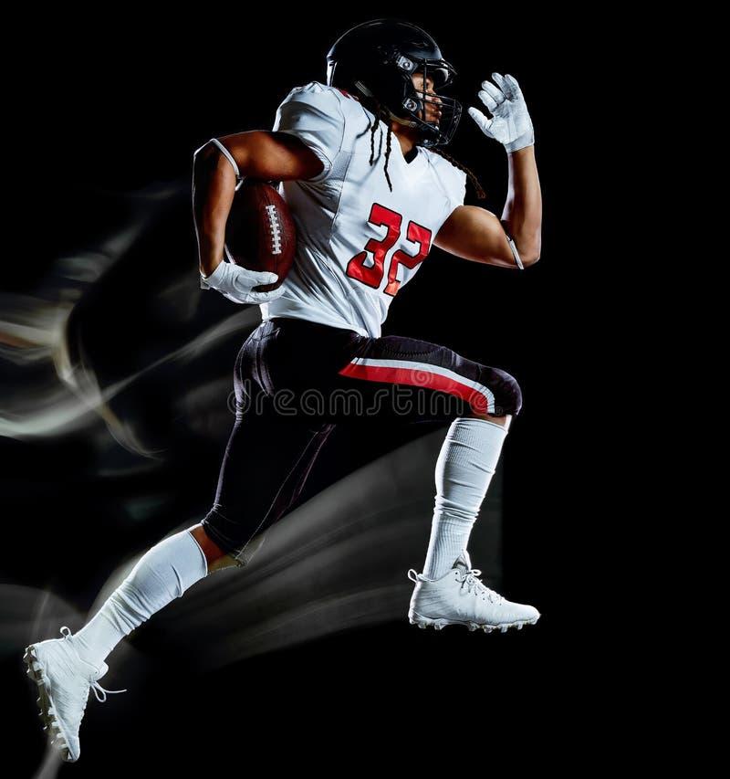 Pintura negra aislada hombre de la luz del fondo del jugador de fútbol americano imagenes de archivo