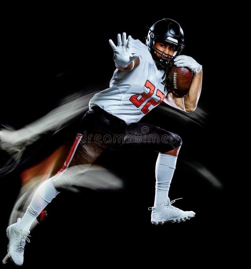Pintura negra aislada hombre de la luz del fondo del jugador de f?tbol americano fotografía de archivo